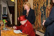 Oxford, GREAT BRITAIN., Royal visit to Magdalen College, by Her Majesty the Queen, Royal Highness the Duke of Edinburgh, Thursday 27/11/2008, [Mandatory Credit Peter Spurrier] Oxford, GREAT BRITAIN., Signing the Visitors Book, Royal visit to Magdalen College, by Her Majesty the Queen, Royal Highness the Duke of Edinburgh, Thursday 27/11/2008, [Mandatory Credit Peter Spurrier]