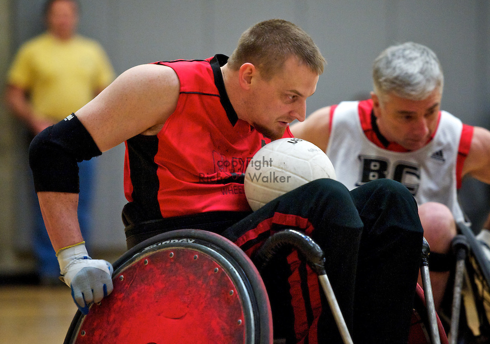 2011 January 23 - Seattle Slam's Neil Sperry moves ahead of Curt Chapman playing for Team BC in Battle in Seattle wheelchair rugby at the Southwest Community Center, West Seattle, WA. CREDIT: Richard Walker