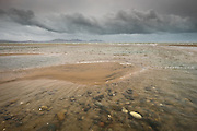 As Storm Imogen makes her first appearance, and dark clouds build on the the horizon, I find myself fascinated by the sheer variety of beautiful coloured stones lying just beneath the surface of the sand pools before an incoming tide. The weather created dreary conditions but every so often gentle glimmers of light illuminated this wet world, a world that has seen rain for almost three months solid. It was so lovely to find such intriguing beauty in such inclement weather