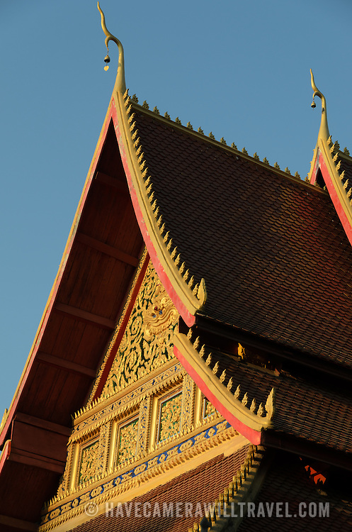 An ornately decorated roof of a Wat (Buddhist temple) in Vientiane, Laos.