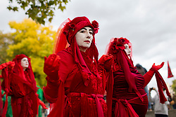 © Licensed to London News Pictures. 06/10/2019. London, UK. An Extinction Rebellion protester performs at Marble Arch as protesters gather to mark the beginning of two weeks of direct action in London. Photo credit: George Cracknell Wright/LNP