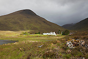 View of the Cluianie Inn, from the head of Loch Cluanie, overlooked by the North Glen Shiel Ridge.