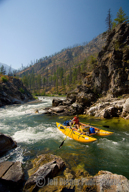 A rafter navigates the Pistol Creek Rapid (class 3-4).  Middle Fork of the Salmon River.  Frank Church-River of No Return Wilderness, Idaho.
