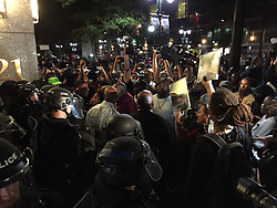 Protesters confront police officers near Trade and Tryon Streets in Charlotte, NC, USA, on Thursday, September 22, 2016, as demonstrations continue following the shooting death of Keith Scott by police earlier in the week. Photo by Jeff Siner/Charlotte Observer/TNS/ABACAPRESS.COM