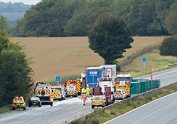 © Licensed to London News Pictures; 24/09/2020; M4, near Grittleton, Wiltshire, UK. Emergency Services attend a second fatal accident on the M4, this time on the westbound carriageway involving two lorries, a car and a van. Two people died in the two separate crashes on the M4 overnight. The first happened at about 01:35 BST when a car overturned between Bath and Chippenham, killing one man and leaving another with life-threatening injuries. Two lorries, a car and a van then crashed in the same area between junctions 17 and 18. One man died and two others were injured. Emergency services say two serious accidents on the M4 have caused the motorway to be shut and it may remain shut all morning, and have been long delays on diversion routes. A third accident has been reported westbound before junction 17. Photo credit: Simon Chapman/LNP.