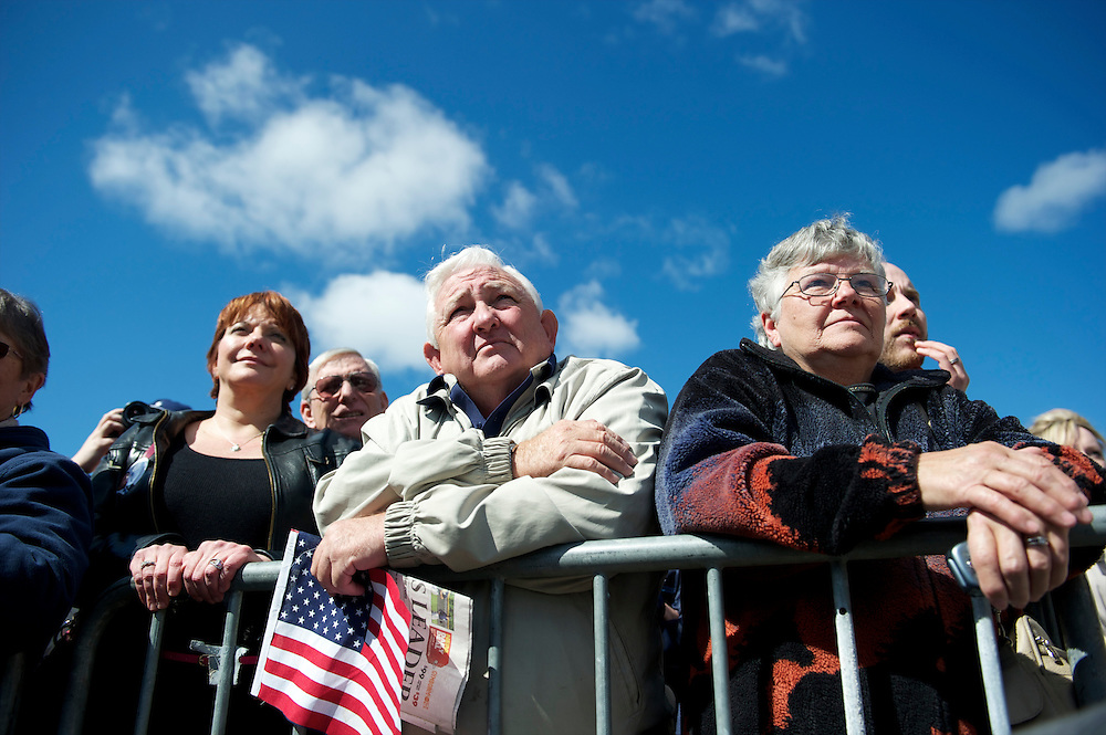 Supporters listen to Republican Presidential candidate Mitt Romney during a rally at Mountain Energy Services in Tunkhannock, Pennsylvania on April 5, 2012.