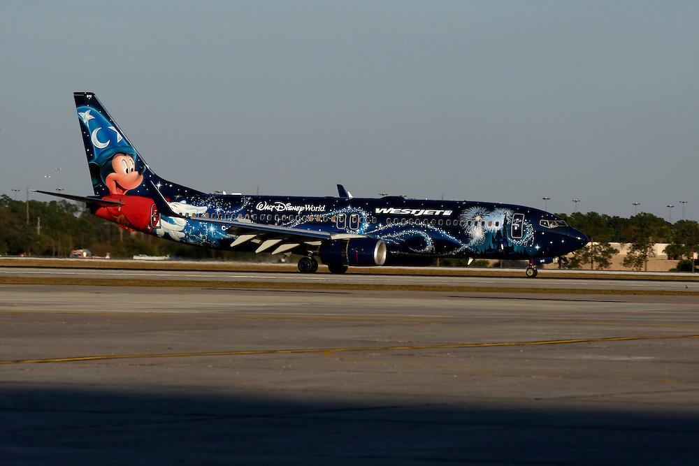 Dec 3, 2013; Orlando, FL, USA; The arrival of WestJet 1414, aka Magic Flight, at Orlando International Airport.