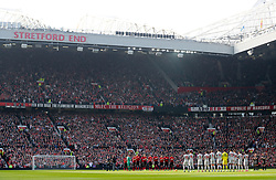 Players hold a minutes silenc in tribute to Manchester United Youth team coach Eric Harrison
