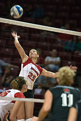 19 AUG 2006  Peggy Riessen reaches back for a kill attempt. Northern Illinois Huskies got slammed by Illinois State Redbirds, losing the match 3 games to 1. Game action took place at Redbird Arena on the campus of Illinois State University in Normal Illinois.
