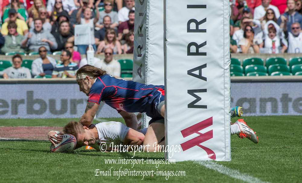 Twickenham. UK. Tom MITCHELL touches down and feels the full weight of Garrett BENDER, through his forearm during the Cup Semi final at the ,2015. Marriott London Sevens. RFU Twickenham Stadium. Surrey. 17.05.2015. [Mandatory Credit: Peter Spurrier/Intersport Images]