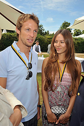 JENSON BUTTON and JESSICA MICHIBATA at a luncheon hosted by Cartier for their sponsorship of the Style et Luxe part of the Goodwood Festival of Speed at Goodwood House, West Sussex on 5th July 2009.