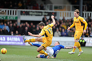Newport's Andy Sandell of Newport county shoots and scores his sides 3rd goal.   Skybet football league two match, Newport county v Chesterfield at Rodney Parade in Newport, South Wales on Sunday 1st Dec 2013. pic by Andrew Orchard, Andrew Orchard sports photography,