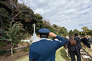 A Pakistani airforce Corporal salutes during the Remembrance Sunday ceremony at the Hodogaya, Commonwealth War Graves Cemetery in Hodogaya, Yokohama, Kanagawa, Japan. Sunday November 12th 2017. The Hodagaya Cemetery holds the remains of more than 1500 servicemen and women, from the Commonwealth but also from Holland and the United States, who died as prisoners of war or during the Allied occupation of Japan. Each year officials from the British and Commonwealth embassies, the British Legion and the British Chamber of Commerce honour the dead at a ceremony in this beautiful cemetery.