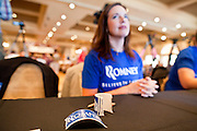 14 SEPTEMBER 2011 - SUN LAKES, AZ: Lisa Caupp, from Chandler, AZ, a Romney volunteer, waits to sign people in before a Mitt Romney election rally in the ballroom at the Oakwood Clubhouse at Sun Lakes Wednesday. Romney was one of the first of the 2012 Republicans running for the GOP Presidential nomination to come to Arizona. He campaigned Wednesday in Tucson and Sun Lakes and attended a private event in Tempe.       PHOTO BY JACK KURTZ