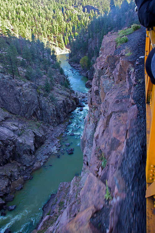 The Durango & Silveton Railroad runs alongside the Animas River gorge, often precariously close to steep drop-offs like this one. I had to keep from imaging the rocks crumbling and breaking off from the edge!