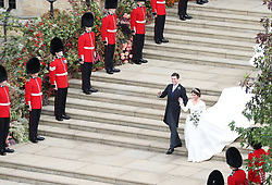 Princess Eugenie and her new husband Jack Brooksbank leave St George's Chapel in Windsor Castle following their wedding. 12 Oct 2018 Pictured: Princess Eugenie and her new husband Jack Brooksbank. Photo credit: WPA POOL/Mega TheMegaAgency.com +1 888 505 6342