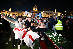 © Licensed to London News Pictures. 07/07/2021. London, UK. England fans celebrate at the final whistle. England fans gather at the Fan Zone in Trafalgar Square, central London, for the Euro 2020 semi final between England and Denmark. England are attempting to reach their first final since 1966. Photo credit: Ben Cawthra/LNP