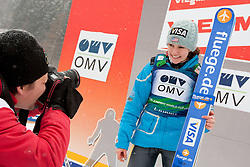 Photographer Vid Ponikvar taking pictures of winner Sarah Hendrickson of USA after the Normal Hill Individual Competition at FIS World Cup Ski jumping Ladies Ljubno 2012, on February 12, 2012 in Ljubno ob Savinji, Slovenia. (Photo By Grega Valancic / Sportida.com)