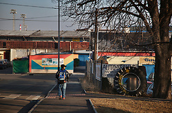 "A young boy walks to school in the industrial neighborhood where Zakladni Skola is located in Ostrava, Czech Republic on March 5, 2012.  Several of the 18 Roma children who were represented in the D.H. and Others v. Czech Republic case, the first challenge to systemic racial segregation in education to reach the European Court of Human Rights, live in this city. When this case was first brought in 2000, Roma children in the Czech Republic were 27 times more likely to be placed in ""special schools,"" intended for the mentally disabled, than non-Roma children. In 2007, the Grand Chamber of the European Court of Human Rights ruled that this pattern of segregation violated nondiscrimination protections in the European Convention on Human Rights. Despite this landmark decision, little change has occurred: the ""special schools"" have been renamed but follow the same substandard curriculum and Roma continue to be assigned to these schools in disproportionate numbers. The process of integration has barely begun."