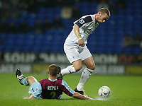 Photo: Aidan Ellis.<br /> Bolton Wanderers v West Ham Utd. Carling Cup.<br /> 26/10/2005.<br /> Bolton's Kevin Nolan nudges the ball away from the cahllenge of west ham's Thomas Repka