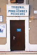 Gruissan village. La Clape. Languedoc. A door. Tribunal des Prud'hommes Pecheurs - the court of prudhommes, work law, for fishermen. France. Europe.