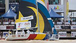 Peter Gilmour (AUS), YANMAR Racing in front of the Ri-Yaz Marina Building. Monsoon Cup 2009. Kuala Terengganu, Malaysia. 3 December 2009. Photo: Sander van der Borch / Subzero Images