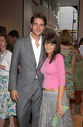 KRIS THYKIER and CLAUDIA WINKLEMAN at a party to celebrate the publication of iPod, Therefore I am by Dylan Jones held at Asprey, 169 New Bond Street, London W1 on 14th July 2005.<br /><br />NON EXCLUSIVE - WORLD RIGHTS