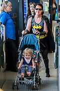 Even super heroes and vilains have to use the tube. London Film and Comic Con 2014, (LFCC), at Earls Court, London, UK.