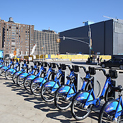 A Citi Bike docking station in Manhattan, New York. Citi Bike the NYC Bicycle Share Program sponsored by Citi Bank, launched in late May 2013 giving access to thousands of bikes at docking stations throughout  Manhattan and parts of Brooklyn. Manhattan, New York, USA. 4th June 2013. Photo Tim Clayton