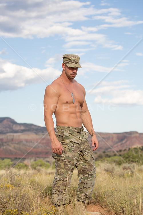 shirtless muscular solider outdoors