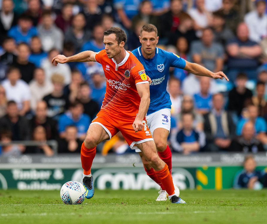 Shrewsbury Town's Shaun Whalley (left) under pressure from Portsmouth's Lee Brown (right) <br /> <br /> Photographer David Horton/CameraSport<br /> <br /> The EFL Sky Bet League One - Portsmouth v Shrewsbury Town - Saturday September 8th 2018 - Fratton Park - Portsmouth<br /> <br /> World Copyright © 2018 CameraSport. All rights reserved. 43 Linden Ave. Countesthorpe. Leicester. England. LE8 5PG - Tel: +44 (0) 116 277 4147 - admin@camerasport.com - www.camerasport.com