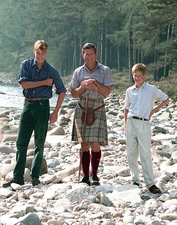 Prince Charles,The Prince of Wales seen with his sons Prince William and Prince Harry on the banks of the River Dee at the Queen's Scottish estate of Balmoral.August 1997. Photographed by Jayne Fincher