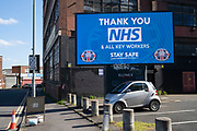 HM Government, and NHS advertising health information advice boards in an inner city area virtually deserted under Coronavirus lockdown on 5th May 2020 in Birmingham, England, United Kingdom. Coronavirus or Covid-19 is a new respiratory illness that has not previously been seen in humans. While much or Europe has been placed into lockdown, the UK government has put in place more stringent rules as part of their long term strategy, and in particular social distancing.
