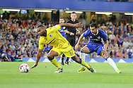 Bristol Rovers forward Jermaine Easter (17) dribbling trying to avoid Chelsea ataacker Pedro (11) during the EFL Cup match between Chelsea and Bristol Rovers at Stamford Bridge, London, England on 23 August 2016. Photo by Matthew Redman.