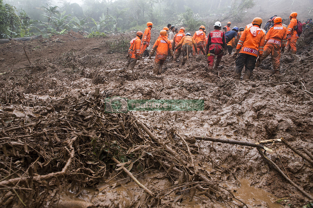 February 6, 2018 - Bogor, Bogor, Indonesia - Bogor, West Java, Indonesia : 06 February 2018 : Team from Indonesia search and rescue still on going process finding victim from landslide at Puncak Bogor, also firefighter try to clean the remaining mud from the landslide with excavator. Landslide hit puncak-bogor due to heavy rain that hit the area in couples days and also by deforestation for villa at the location. (Credit Image: © Donal Husni via ZUMA Wire)
