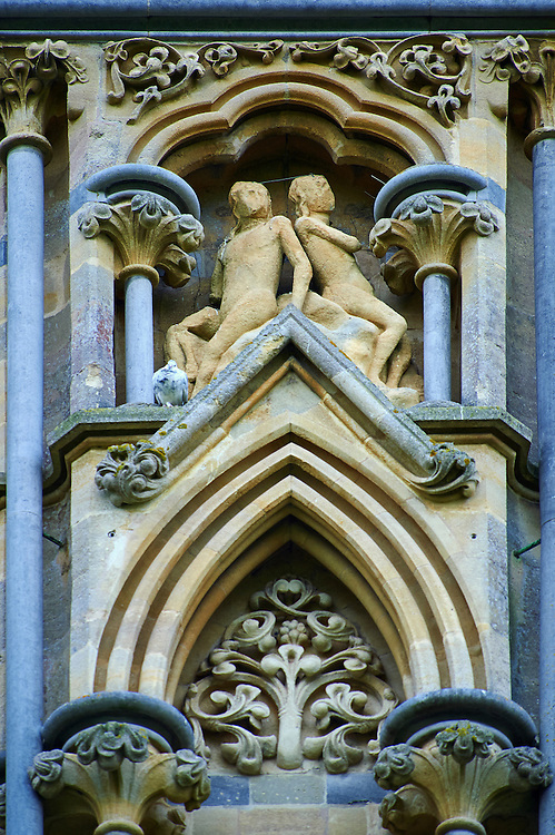 """Statues on the facade of the the medieval Wells Cathedral built in the Early English Gothic style in 1175, Wells Somerset, England . Its Gothic architecture is mostly in Early English style of the late 12th – early 13th centuries. Building began about 1175 at the east end with the choir. Historian John Harvey sees it as Europe's first truly Gothic structure. Its Early English front with 300 sculpted figures, is seen as a """"supreme triumph of the combined plastic arts in England"""".<br /> <br /> Visit our MEDIEVAL PHOTO COLLECTIONS for more   photos  to download or buy as prints https://funkystock.photoshelter.com/gallery-collection/Medieval-Middle-Ages-Historic-Places-Arcaeological-Sites-Pictures-Images-of/C0000B5ZA54_WD0s"""