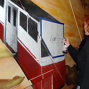 NLD/Huizen/20070309 - Opening vernieuwde jongerencentrum Tramontano met een nieuwe naam TRAM op de muur geschilderd door wethouder