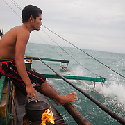 RJ cooks rice for their breakfast. Joseph is 17 and works like his father did on the sea as a fisherman. The catch of the day is hauled in by the entire crew to be sorted out on deck and taken straight to the market in Hinigaran. The catch that day made the crew $12.00 each( Captain Joan $24.00) One day a week Joseph goes to Alternative Learning schooling provided by Quidan-Kaisahan.  Quidan-Kaisahan is a charity working in Negros Occidental in the Philippines. Their aim is to keep children out of work to secure them education.
