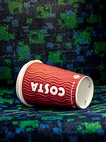 A coffee or tea cup from COSTA has been left behind on the seat on a train in the London area.