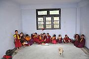 Young novice monks in a classroom at a school in Sikkim, India