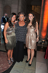 Left to right, SOPHIA SEDLEY, CARMEL CLAYTON and JESSICA SEDLEY at the 50th birthday party for Jonathan Shalit held at the V&A Museum, London on 17th April 2012.