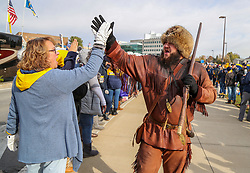 Nov 9, 2019; Morgantown, WV, USA; The West Virginia Mountaineers mascot celebrates with fans before their game against the Texas Tech Red Raiders at Mountaineer Field at Milan Puskar Stadium. Mandatory Credit: Ben Queen-USA TODAY Sports