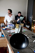 A Requiem For The Foghorn, performed by a seventy five piece brass band, a foghorn and an armada of ships playing their remote controlled foghorns.<br /> <br /> A fog horn sits in the workshop in Newcastle waiting to be installed on a ship. Joshua Portway works on last minute technical preparations in the back ground. <br /> <br /> Preparations of the Fog Horn Requiem a few hours before the concert is about to start. Last minute installations and adjustments in the workshop and on the ships participating with remote controled horns. <br /> <br /> A project by Danish artist, Lise Autogena, in collaboration with Joshua Portway and composer Orlando Gough. The performance took place by Souter Light House by South Shields, UK with thousands of spectators and more than 50 ships off-shore.