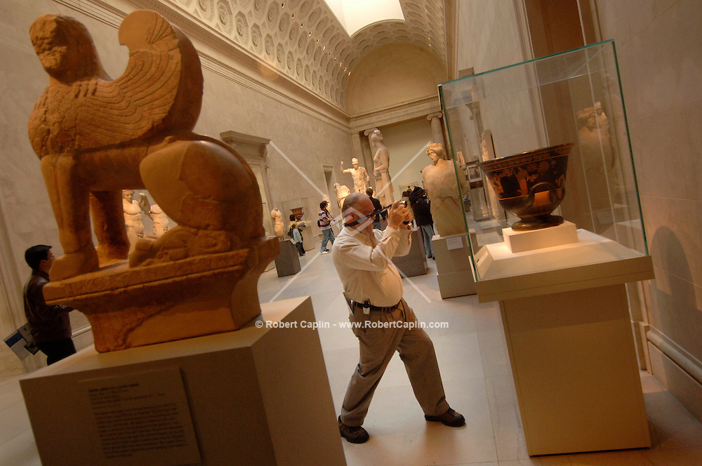 Chet Sergey, of Connecticut, visits the Tarracotta calyx-krater (bowl for mixing wine and water), a piece from the Shelly White and Leon Levy Collection, at the Metropolitan Museum of Art in Manhattan, Thursday, Dec. 8, 2005.