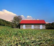 An Abandoned Brick Barn And Pastureland Photographed At Ground Level,.Southwestern Ohio; USA