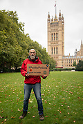 Paid to Pollute claimant Jeremy Cox outside Victoria Tower Gardens South on 2nd October 2021 in London, United Kingdom. Kairin and Jeremy are two of the three climate activists taking the UK government to court over the billions of pounds of public money it spends supporting the oil and gas industry, as part of the Paid to Pollute campaign. <br /> <br /> Jeremy Cox is a retired former oil worker, current Extinction Rebellion activist, beekeeper, green woodworker and amateur baker.