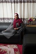 Iqra Ali Gaal has her portrait taken in her apartment in Hamilton, Canada
