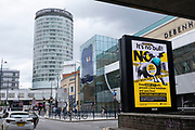 As numbers of Covid-19 cases in Birmingham have increased in recent weeks, and with the city added as an area of enhanced support on the UKs coronavirus watchlist of critical areas which are under threat of a local lockdown, people interact beneath a new public health advice advertising campaign featuring Bully the Bull Ring bull wearing a face mask with the slogan Its NO bull. Keep Brum safe near to the iconic Rotunda building in the city centre on 24th August 2020 in London, United Kingdom. With other areas in the Midlands under localised lockdown, people and businesses are being urged to follow the Coronavirus advice for workplace and family life help reduce the risk.