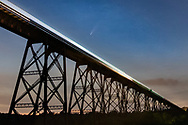 Comet Neowise shines above a train passing over the Moodna Viaduct railroad trestle in the Town of Cornwall, N.Y., on July 18, 2020.