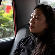 Vanessa Mae Rodel (42), and her daughter Keana Nihinsa (7), ride in a taxi to the Hong Kong International Airport on  March 25, 2019, where they will fly to Canada. / Photo: Maria de la Guardia